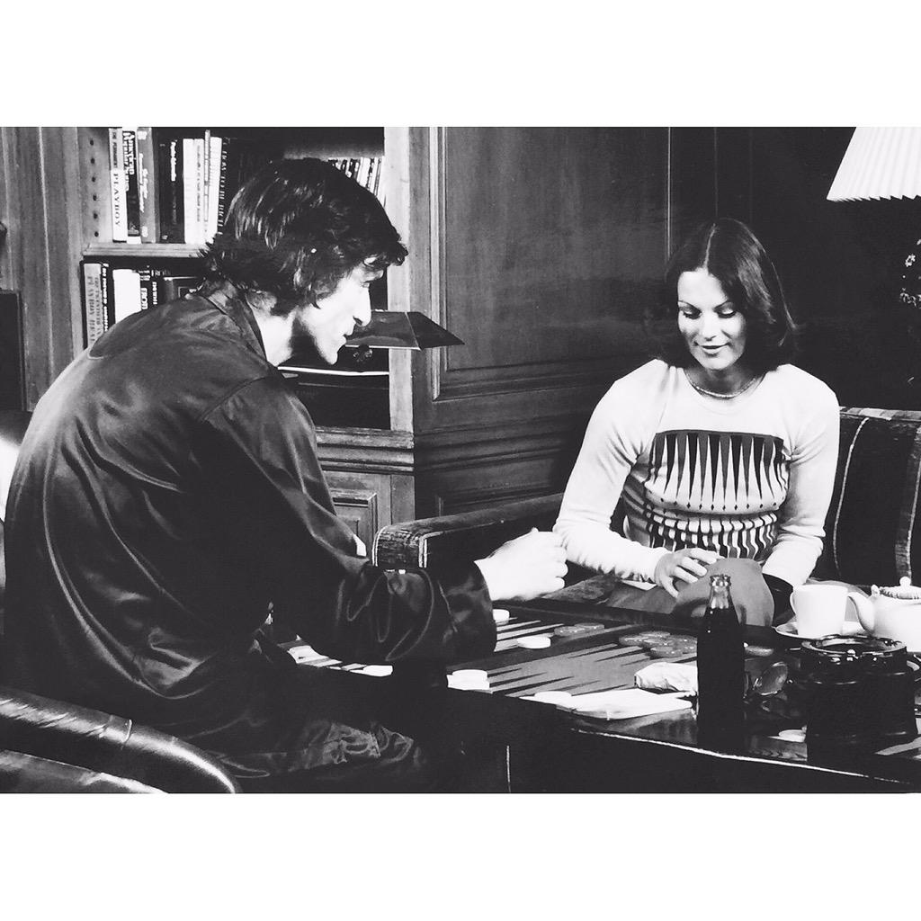 Hugh Hefner playing backgammon with this daughter Christie in 1974